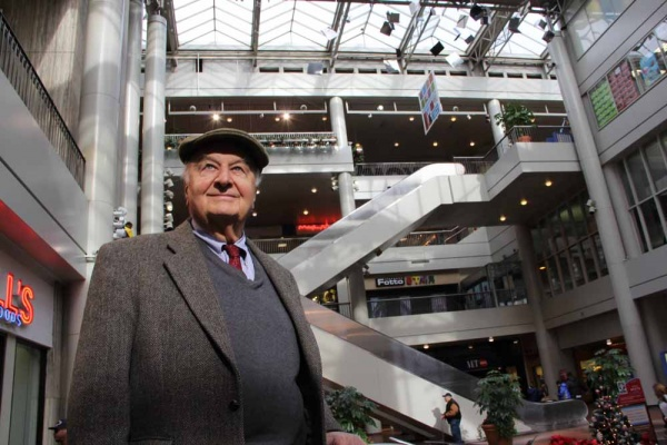 """<p><p>Architect John Bower stands in the atrium of The Gallery mall on Market Street, which opened in 1974. """"It has great potential and has reached the point in its life where it needs to be spruced up and revitalized,"""" he said. (Emma Lee/for NewsWorks)</p></p>"""