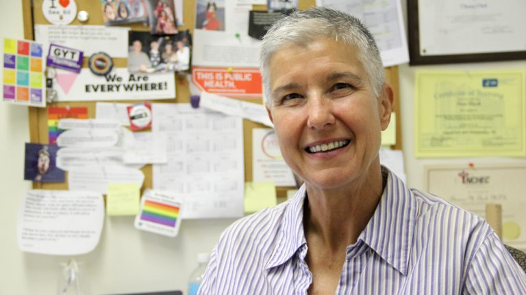 Sex educator Theresa Clark is shown in her office at ActionAIDS on Arch Street in Philadelphia. (Emma Lee/WHYY)