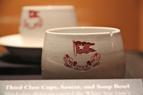 <p>Third class dishes recovered from the wreck of the Titanic were marked with the logo of the White Star Line to discourage theft. (Emma Lee/for NewsWorks)</p>