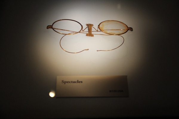 <p>A pair of glasses recovered from the wreck of the titanic is on display at the Franklin Institute. (Emma Lee/for NewsWorks)</p>