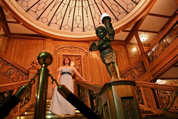 <p>Franklin Institute volunteer Jaclyn Scarborough, portraying silent film actress Dorothy Gibson, descends a replica of the Titanic's grand staircase. (Emma Lee/for NewsWorks)</p>