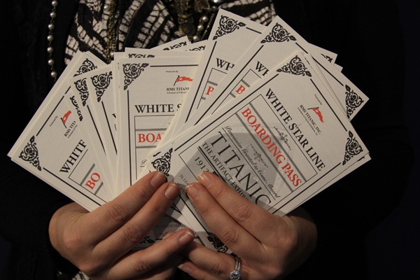 <p>Each visitor to the Franklin Institute's new Titanic exhibit receives a boarding pass containing information about a real passenger. (Emma Lee/for NewsWorks)</p>