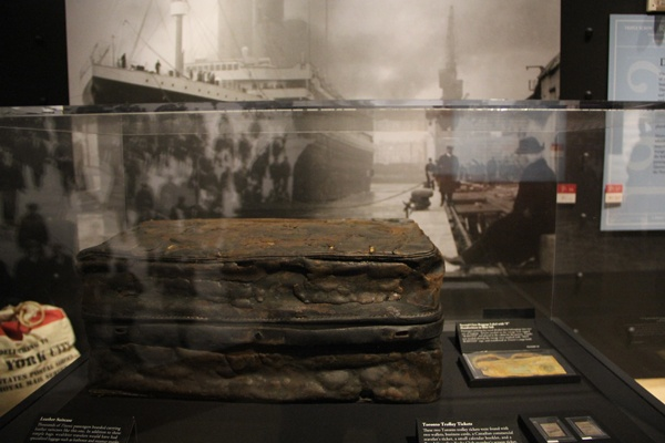 <p>Ordinary objects like this leather suitcase and trolley tickets became extraordinary after surviving the sinking of the Titanic and years beneath the sea. (Emma Lee/for NewsWorks)</p>