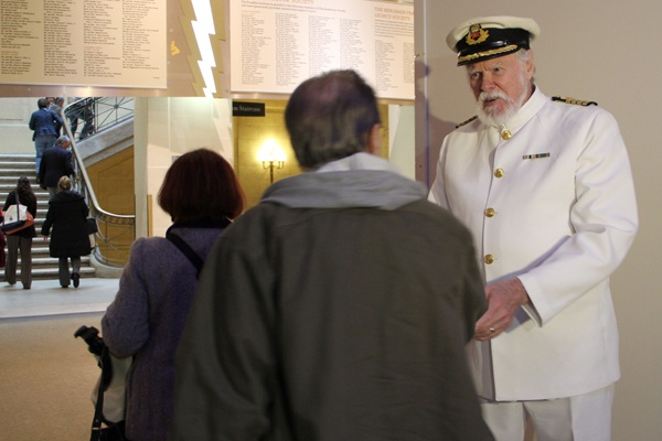 <p>Lowell Lytle, an actor portraying Titanic Captain Edward John Smith welcomes visitors to the Franklin Institute's new exhibit. (Emma Lee/for NewsWorks)</p>