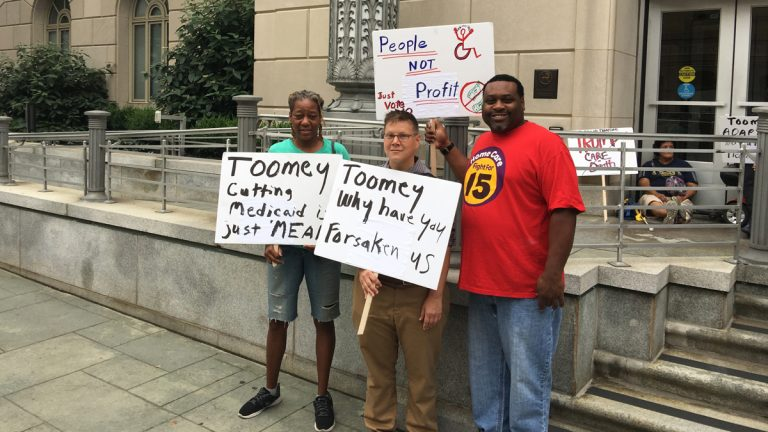 Disability activists demonstrate Tuesday outside the office of U.S. Sen. Pat Toomey at the  Custom House in Philadelphia. (Jay Scott Smith/WHYY)