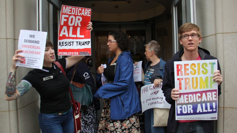 Protesters gather outside the U.S. Custom House where U.S. Sen. Pat Toomey of Pennsylvania has his Philadelphia office. (Emma Lee/WHYY)