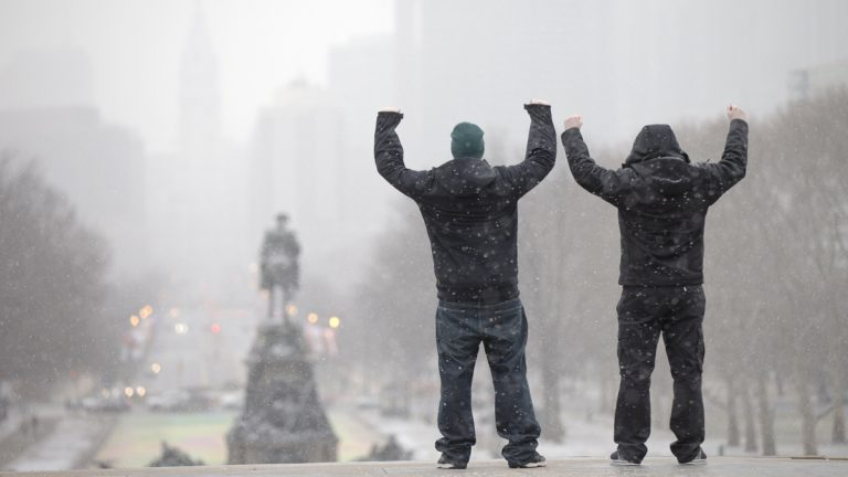 During a winter storm tourists imitate the character Rocky Balboa on the steps of the Philadelphia Museum of Art in Philadelphia, Pa. Philadelphia will host the Democratic National Convention in 2016. (AP Photo/Matt Rourke)