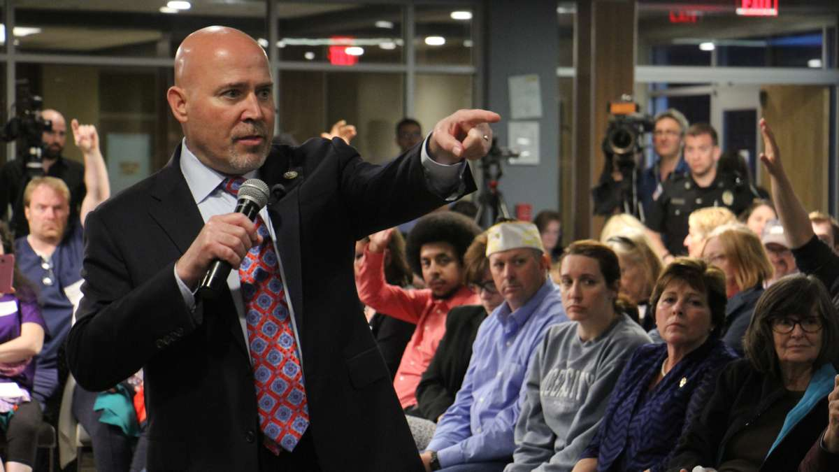 New Jersey Congressman Tom MacArthur faces a tough crowd in Willingboro earlier this month, taking questions about health care, the president's tax returns, and investigations into connections between the White House and Russia.