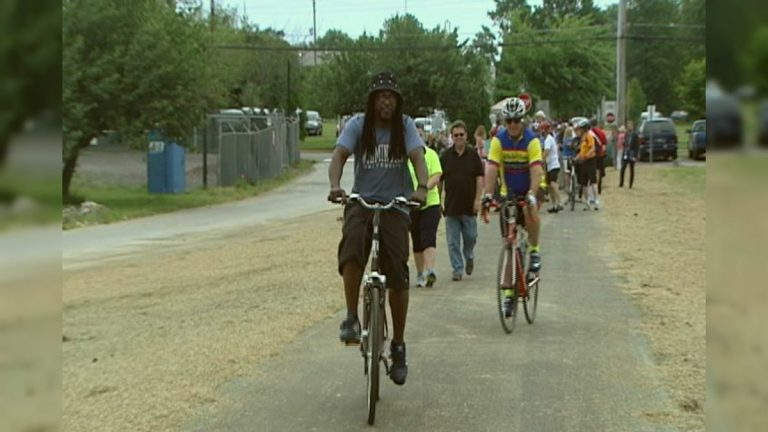 Cyclists take the first ride on the new trail connecting Delaware City to the C&D Canal Trail. (Charlie O'Neill/WHYY)
