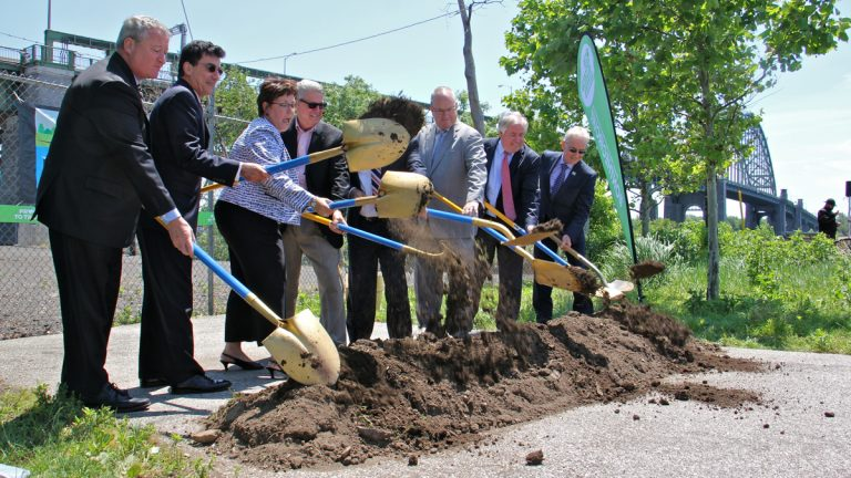 Philadelphia mayor Jim Kenney (left) and other elected and appointed officials ceremoniously break ground for the Kensington and Tacony trail. (Emma Lee/WHYY)
