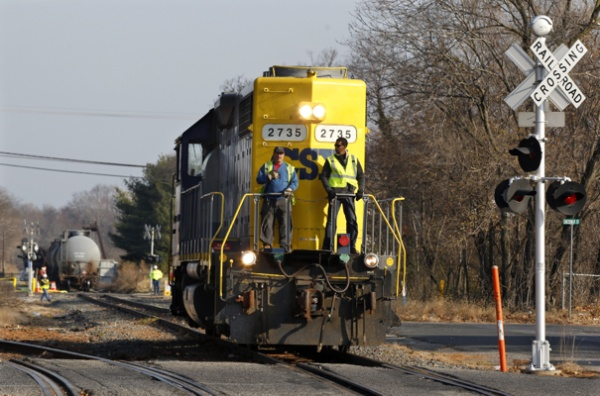 <p>&lt;p&gt;Crew members ride on a locomotive after leaving empty tank cars near derailed train cars in Paulsboro, N.J., on Saturday. (AP Photo/Mel Evans)&lt;/p&gt;</p>