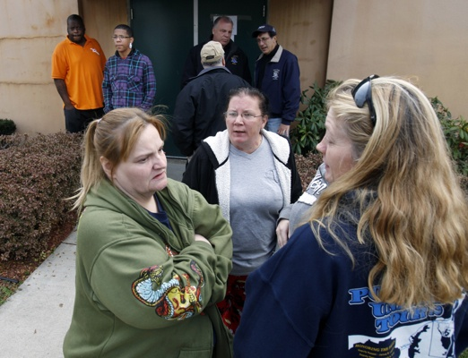 <p>&lt;p&gt;Displaced residents wait for a shuttle bus outside a fire hall and community center in Paulsboro, N.J., Saturday. (AP Photo/Mel Evans)&lt;/p&gt;</p>