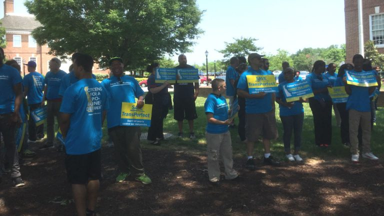 Supporters of a bill that would prevent the sale of TransPerfect gather outside Legislative Hall in Dover on Wednesday. (Zoë Read/WHYY)