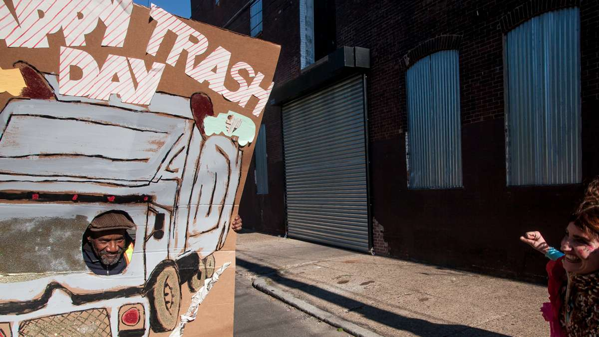 A sanitation worker strikes a pose in the Happy Trash Day attraction. (Brad Larrison/for NewsWorks)