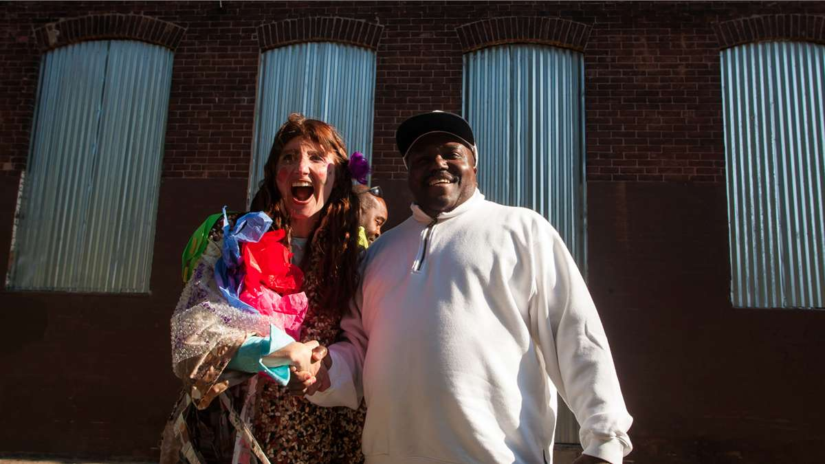 Steve Scott of Philadelphia Streets Department gets a warm welcome at Happy Trash Day. (Brad Larrison/for NewsWorks)