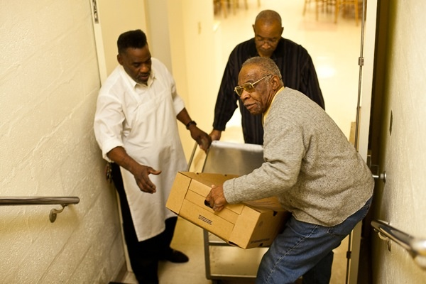 <p><p>Church member L.C. Covington lends a hand and carries a box of turkeys. (Brad Larrison/for NewsWorks)</p></p>