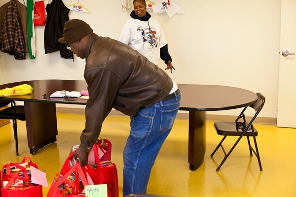 <p><p>Bernard Rivers lends a hand before taking away his own donated turkey as event coordinator Darlene Voykin looks on at Triumph Baptist Church on Germantown and Hunting Park Avenue Saturday. (Brad Larrison/for NewsWorks)</p></p>