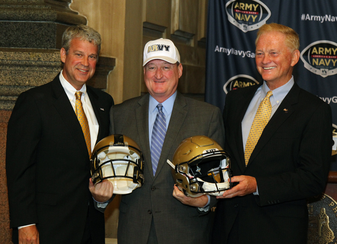 Athletic Directors of the two academy's stand with Mayor Jim Kenney and his unique hat (Tom MacDonald/WHYY)