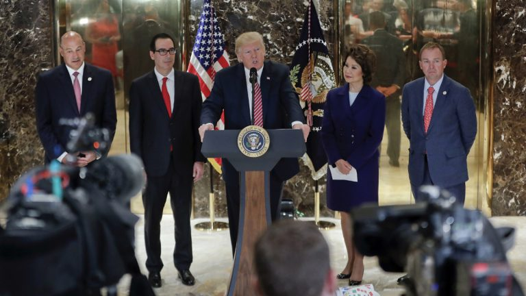 President Donald Trump speaks to the media in the lobby of Trump Tower, Tuesday, Aug. 15, 2017 in New York. With Trump are from left, National Economic Council Director Gary Cohn Treasury Secretary Steven Mnuchin, Transportation Secretary Elaine Chao and OMB Director Mick Mulvaney. (AP Photo/Pablo Martinez Monsivais)