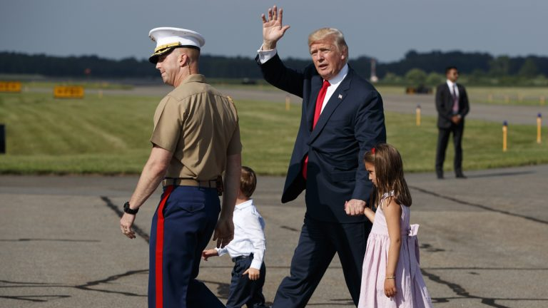 President Donald Trump waves after arriving at Morristown Municipal Airport with his grandchildren, Arabella Kushner, right, and Joseph Kushner to begin his summer vacation at his Bedminster golf club, Friday, Aug. 4, 2017, in Morristown, N.J. (AP Photo/Evan Vucci)