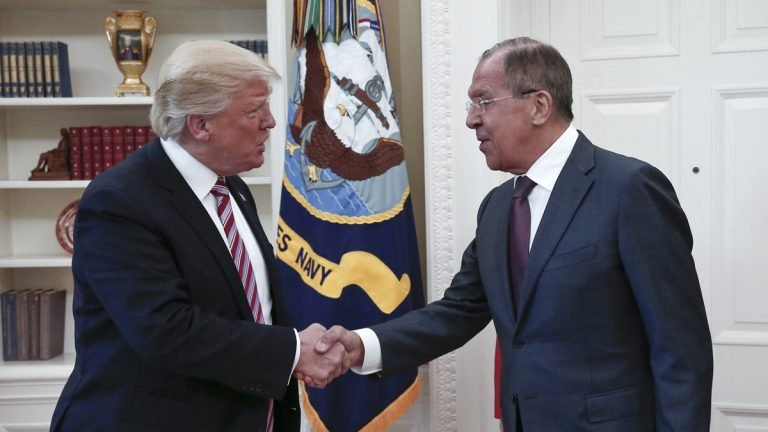 U.S. President Donald Trump, left, shakes hands with Russian Foreign Minister Sergey Lavrov in the White House in Washington on Wednesday. (Russian Foreign Ministry Photo via AP)