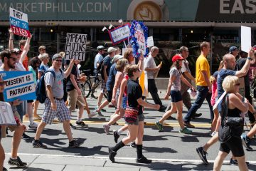 Demonstrators marched down Market Street Sunday morning calling for the impeachment of President Donald Trump. (Brad Larrison for NewsWorks)