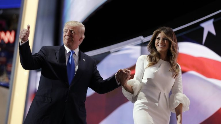Republican presidential candidate Donald Trump gives his thumb up as he walks off the stage with his wife Melania during the Republican National Convention