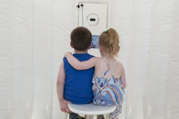 Youngsters prepare to be recorded in the Truth Booth. (Jonathan Wilson for Newsworks)