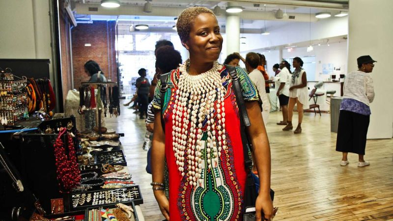 Jasmine Burnett, Deputy Director of New Voices for Reproductive Justice, plans to wear the shell necklace for an upcoming photo shoot to celebrate her birthday. (Kimberly Paynter/WHYY)