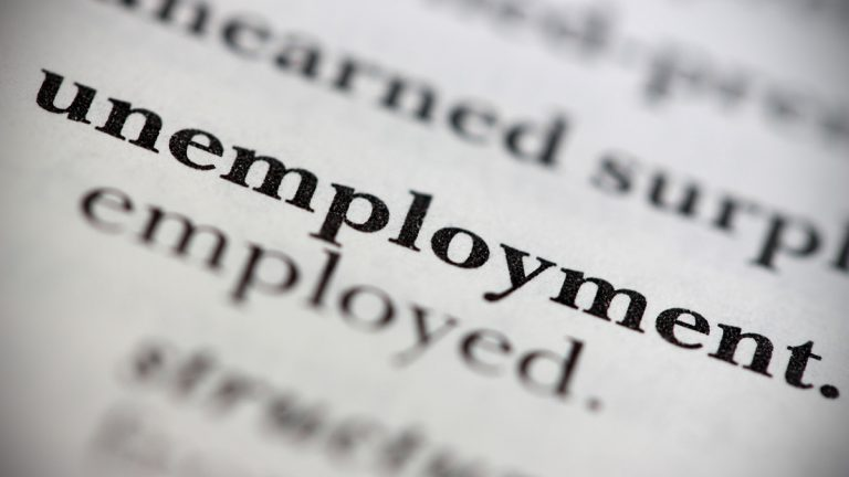 Close up of 'unemployment' dictionary entry (photo via bigstock)