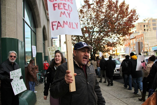 <p>Carmelo Del Valle, a heavy equipment operator from Olney, marches on Spring Garden Street with other unemployed people who want benefits extended. He has been unemployed for more than a year. (Emma Lee/for NewsWorks)</p>