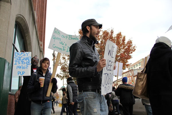 <p>About 30  people march in front of Career Link office on Spring Garden Street. The protestors called for an extension of unemployment benefits and expressed frustration with the unemployment call centers. (Emma Lee/for NewsWorks)</p>