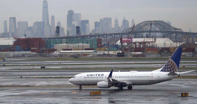 The New York City skyline gives backdrop to a United Airlines airplane taxing at Newark Liberty International Airport, Wednesday, April 12, 2017, in Newark, N.J. (AP Photo/Julio Cortez, file)