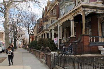 Homes like these on Spruce Street in University City have seen a rapid increase in rents and property taxes. (WHYY, file)