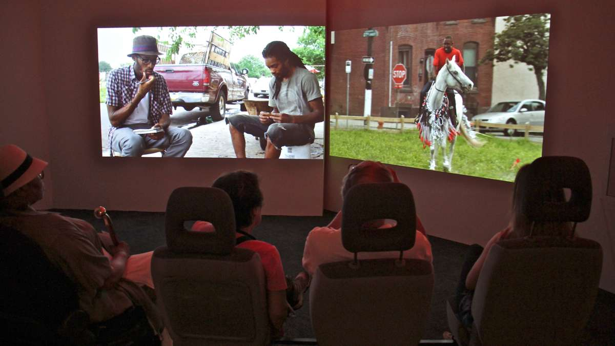 A 13-minute film, ''Horse Day,'' plays on two screens. Viewers sit in car seats.