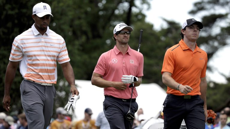 From left: Tiger Woods, Adam Scott, of Australia, and Rory McIlroy, of Northern Ireland, walk down from a tee box during the second round of the U.S. Open golf tournament at Merion Golf Club in Ardmore on Friday. (AP Photo/Gene J. Puskar)