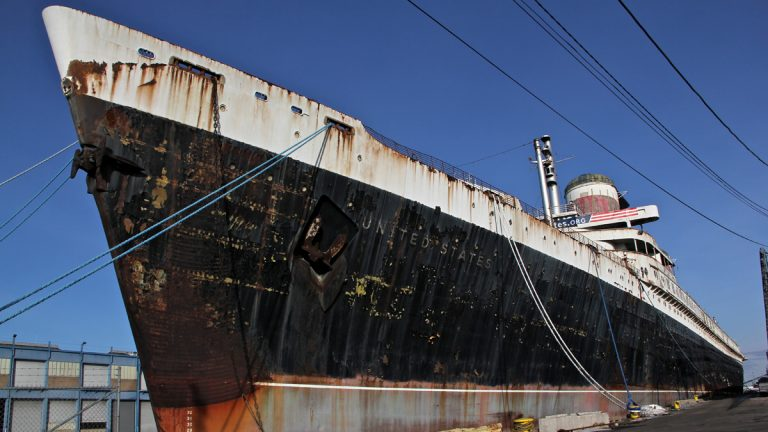 The SS United States, which held speed records for Atlantic crossings, is docked in the Delaware River in South Philadelphia. (Emma Lee/WHYY)