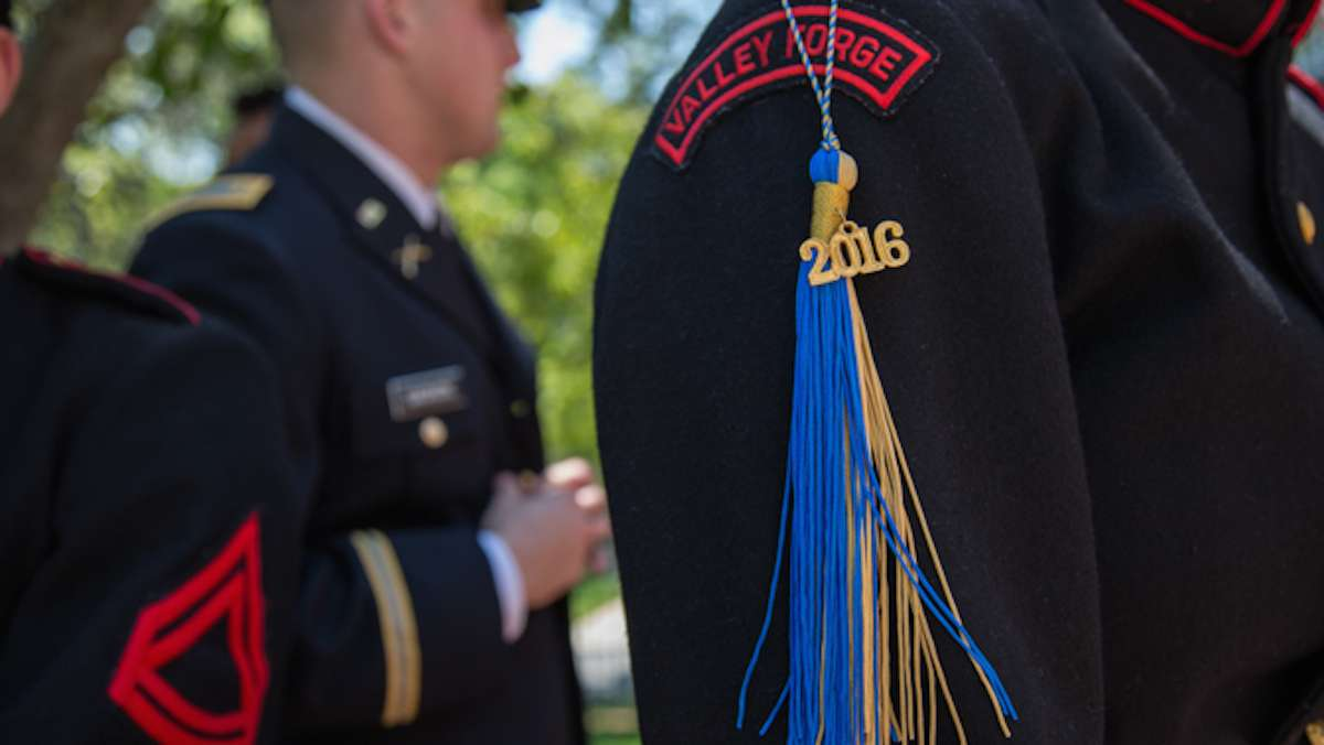 Cadets from the Valley Forge Military College hang their commencement tassels from their uniforms at their graduation, May 20, 2016.