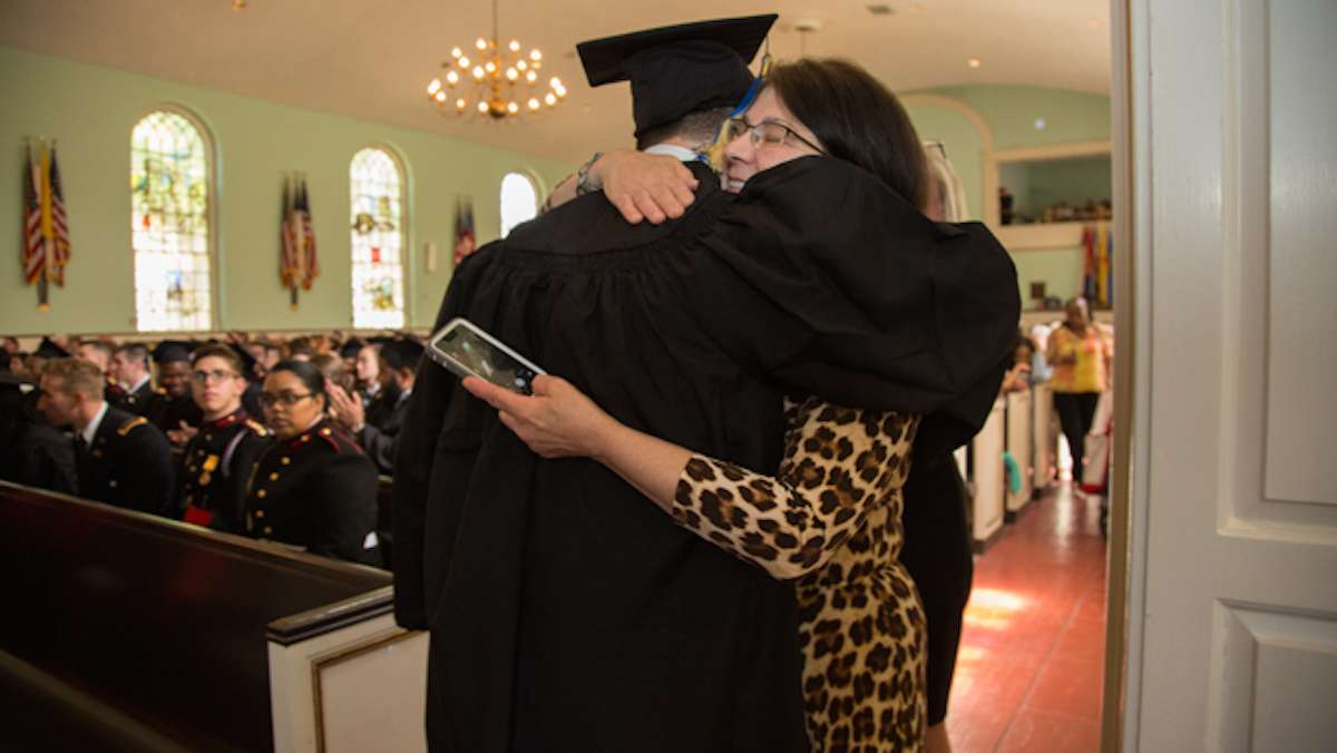 Clarence Morris hugs a family member after receiving his diploma from the Valley Forge Military College, May 20, 2016.