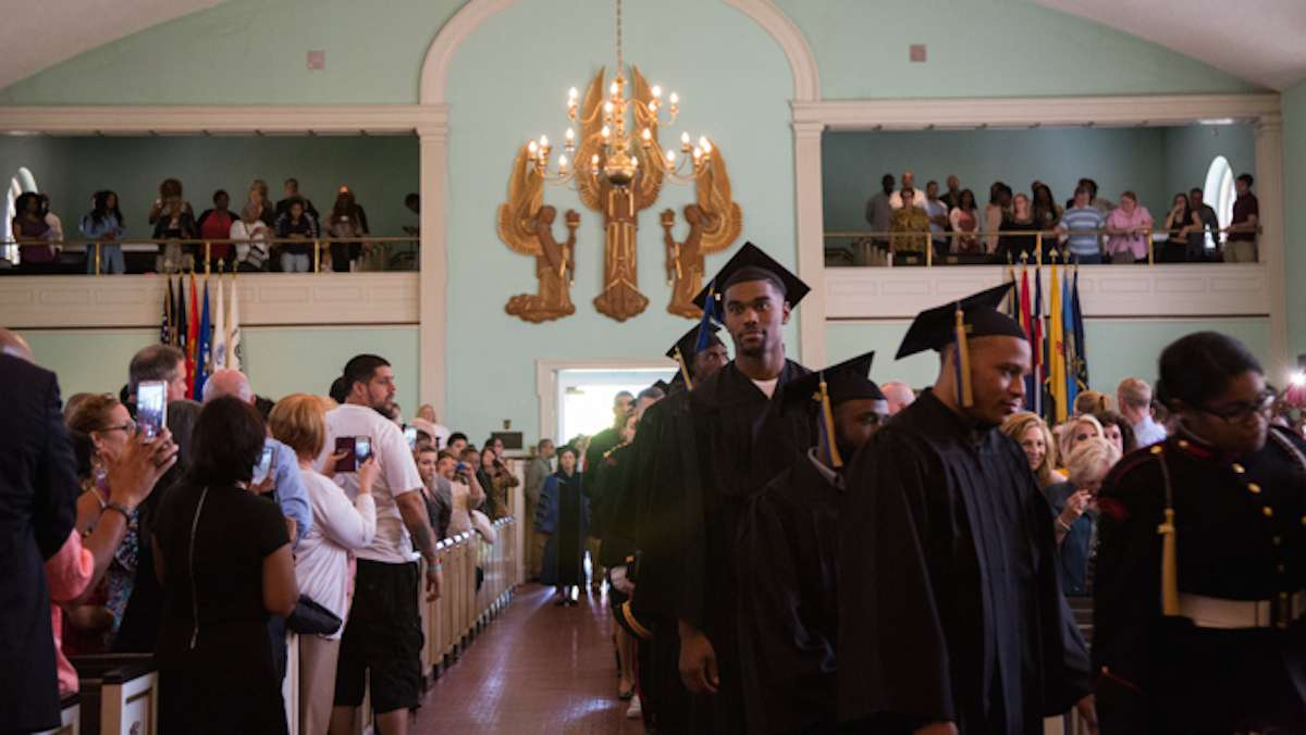 Graduates of the 2016 class at Valley Forge Military College file into the Alumni Memorial Chapel for their graduation ceremony, May 20, 2016. (Emily Cohen for NewsWorks)