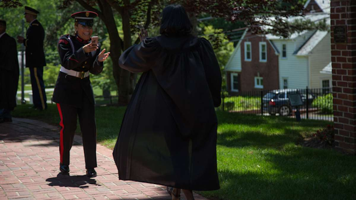A cadet takes a playful video of a non-military classmate as they get ready for their graduation ceremony at the Valley Forge Military College, May 20, 2016.