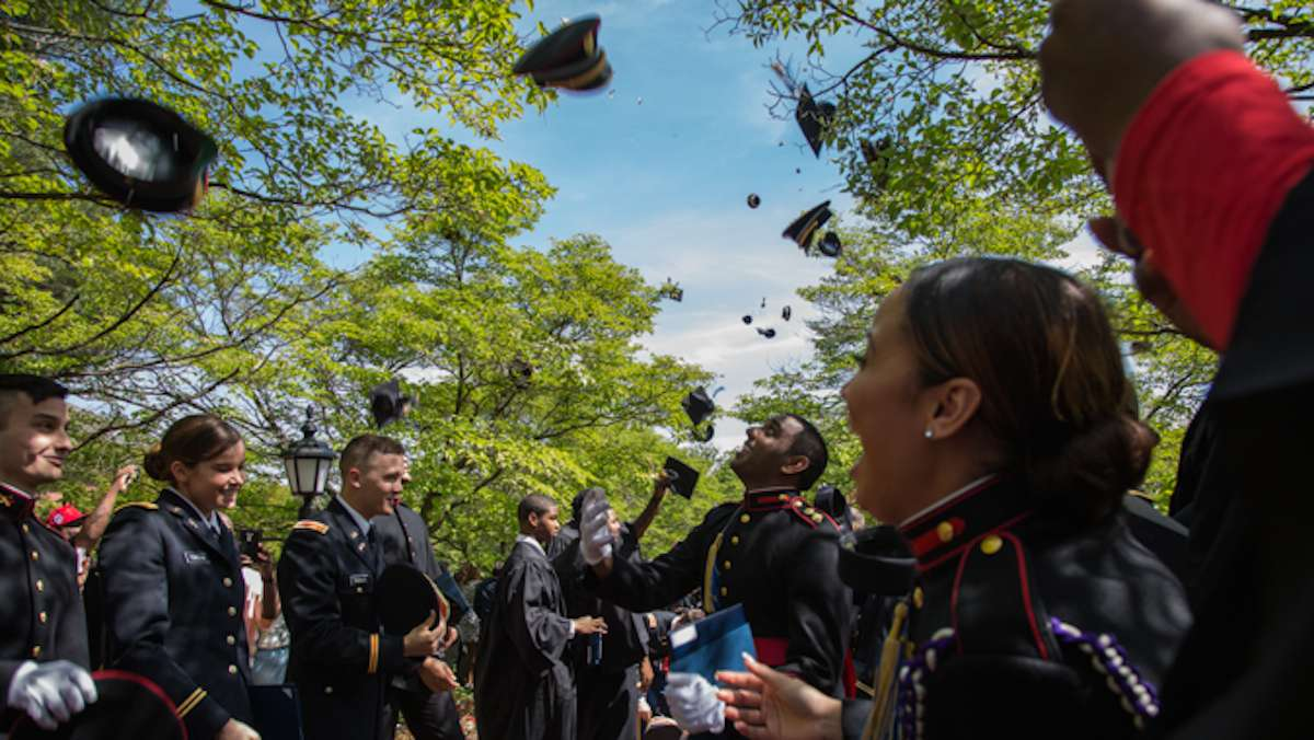 Graduates from the 2016 class of Valley Forge Military College line the pathway outside of the Alumni Memorial Chapel and ceremoniously throw their hats in the air to offically mark their graduaton, May 20, 2016.