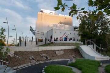 Manayunk residents and reporters attended a tour of the new Venice Island Performing Arts Center Wednesday evening. The exterior includes a rock garden and water play area.