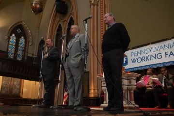Candidates for mayor (from left) Nelson Diaz, Anthony Williams, and James Kenney share their views Saturday afternoon during a mayoral candidate forum organized by Pennsylvania Working Families Organization at the Arch Street United Methodist Church in center city. Behind them are the emcee, Bishop Dwayne D. Royster, and candidate Doug Oliver, right.
