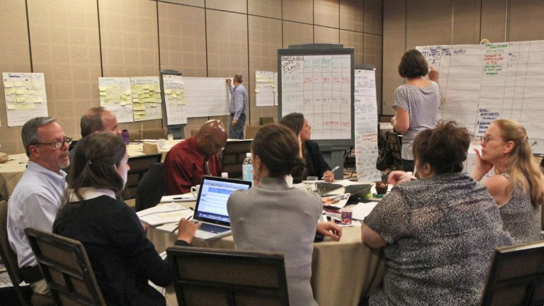 At the Veterans Service Conference, discussion groups set goals for the next 100 days. (Kimberly Paynter/WHYY)