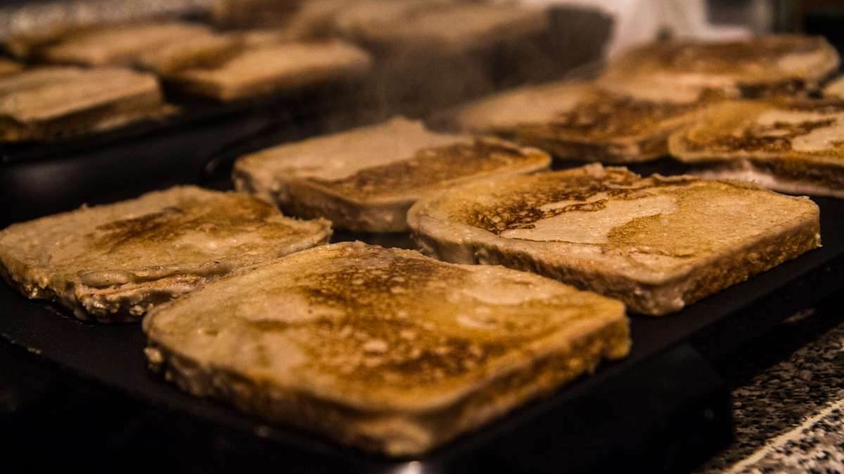 Vegan French toast slices cook on the griddle in the kitchen of Lava Space.