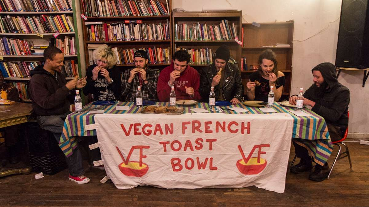 Eaters compete to win a haircut and free food at the 3rd annual Vegan French Toast Bowl at Lava Space in West Philadelphia.