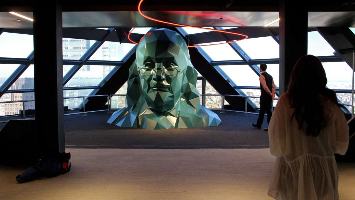 On the 57th floor, Ben Franklin's head emerges.