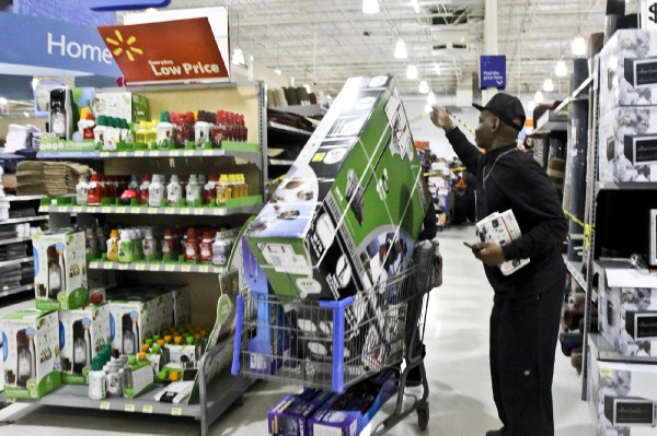 <p>Although Walmart has set up caution tape at the end of some aisles, employees help shoppers move easily through the rows. (Kimberly Paynter/for NewsWorks)</p>