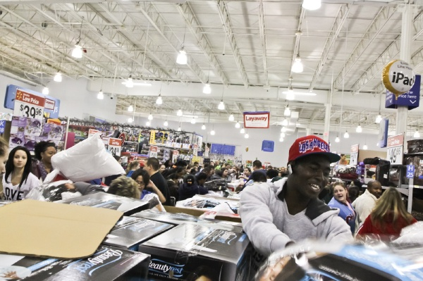 <p><p>Shoppers begin grabbing for the deals when one of the store's many employees begins to unwrap the boxes. (Kimberly Paynter/for NewsWorks)</p></p>